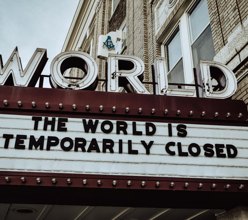 "world theater marquee sign that reads ""the world is temporarily closed"""