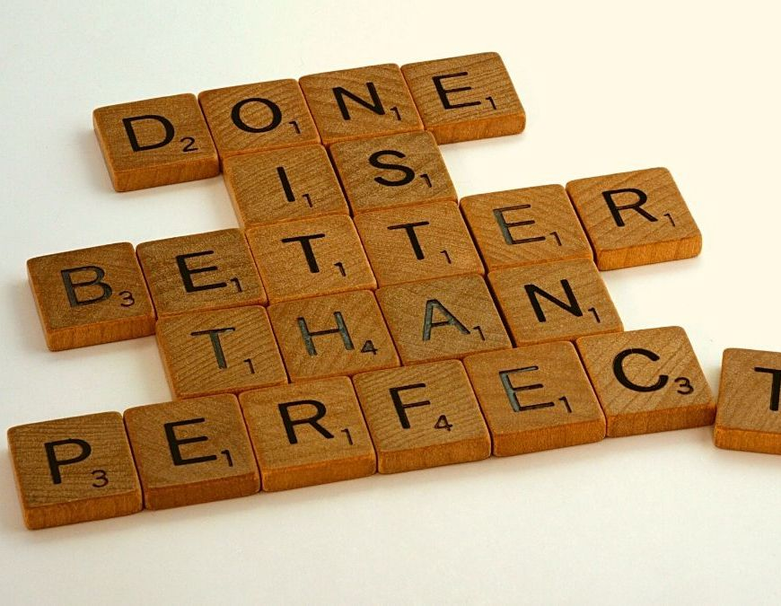 """scrabble letters that read """"done is better than perfect"""" on a white background"""