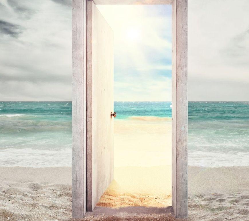 doorframe with open door on the beach facing out to the ocean