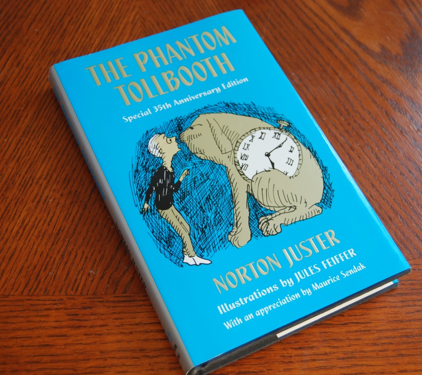 phantom tollbooth book on a wooden surface